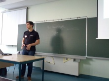 "Benoit presenting his talk ""Scaling configuration management: from central orchestration to peer to peer"""